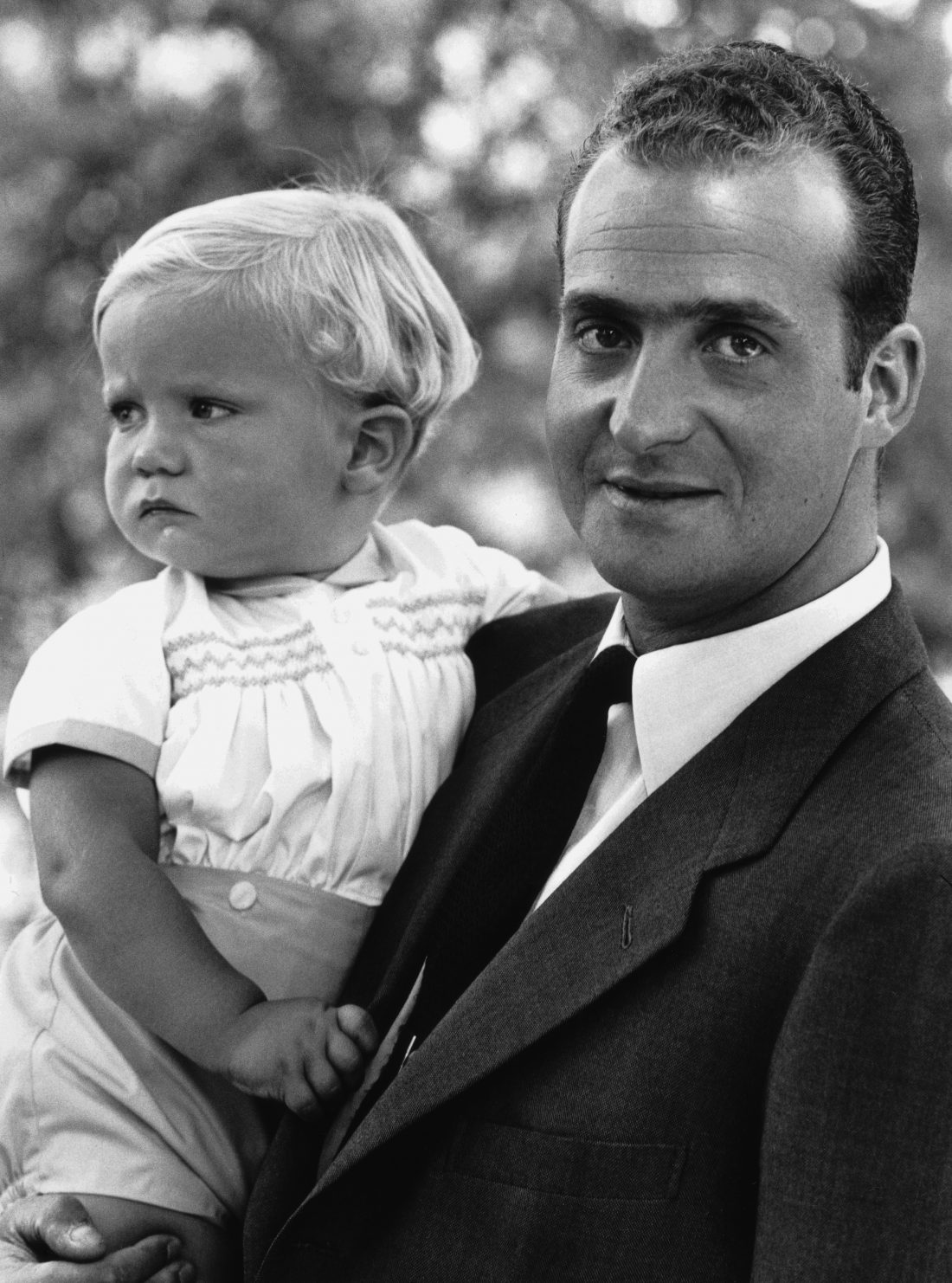 King Juan Carlos I of Spain with his baby son Prince Felipe, 29th July 1969. (Photo by Express/Hulton Archive/Getty Images)